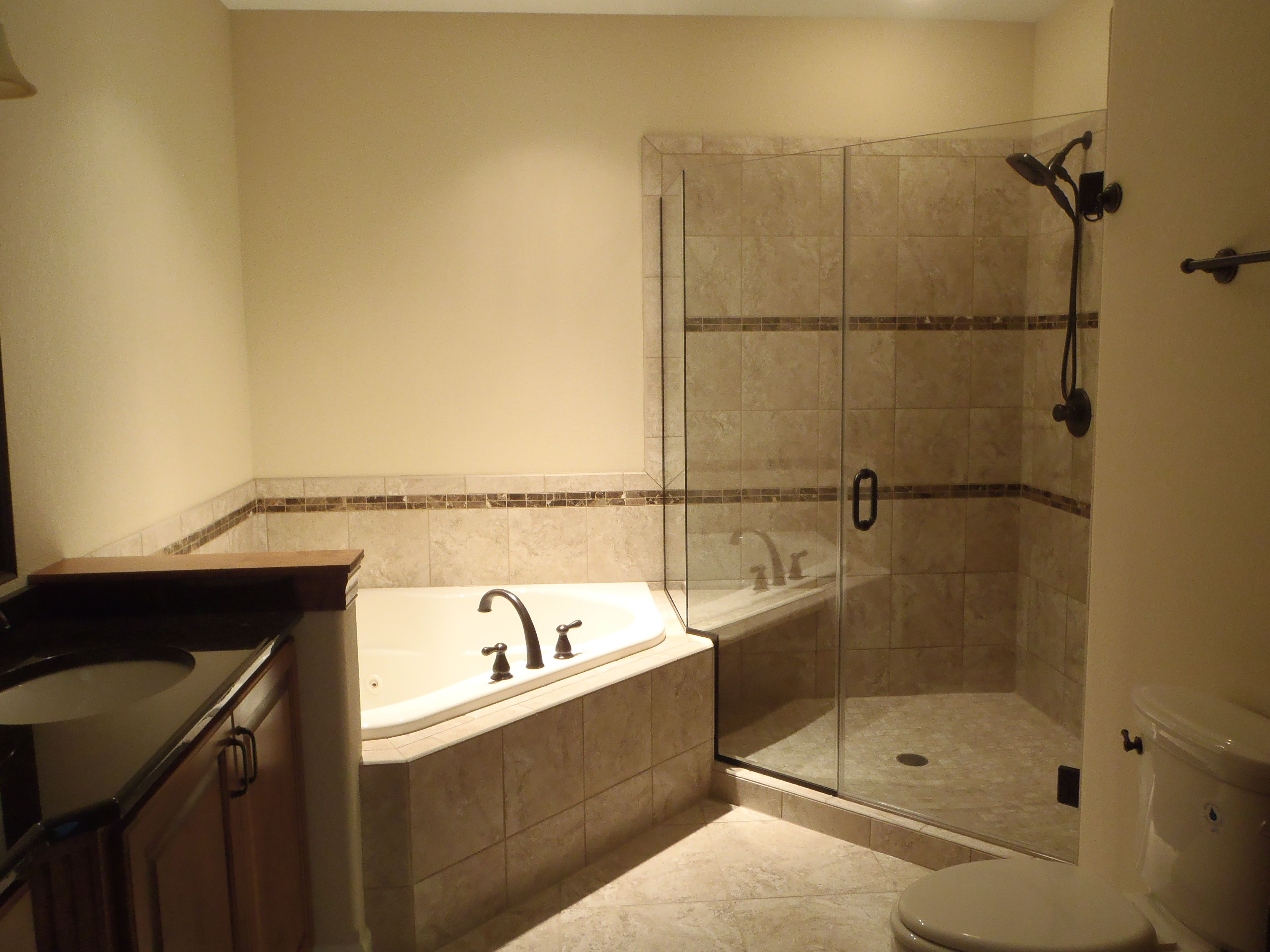 Using light tile and enclosing your shower in glass can make your bathroom feel larger. For more information visit www.carstensenhomes.com