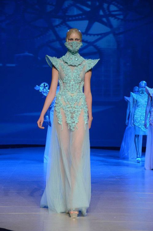 Love the shoulders and the neck/face piece. Also love how it's see through around the beading.