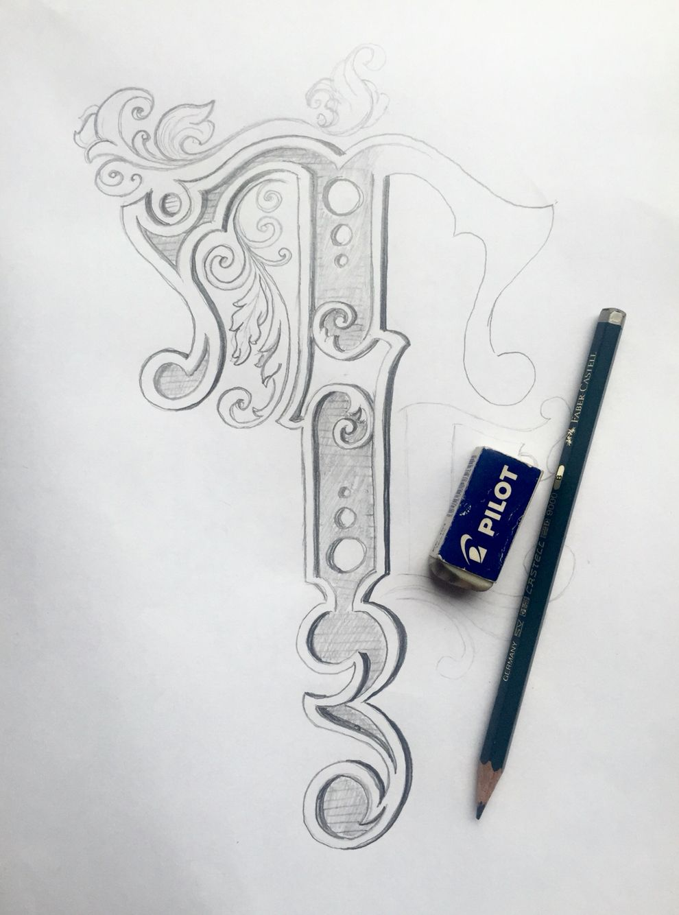 Pencil sketch of a letter t in progress