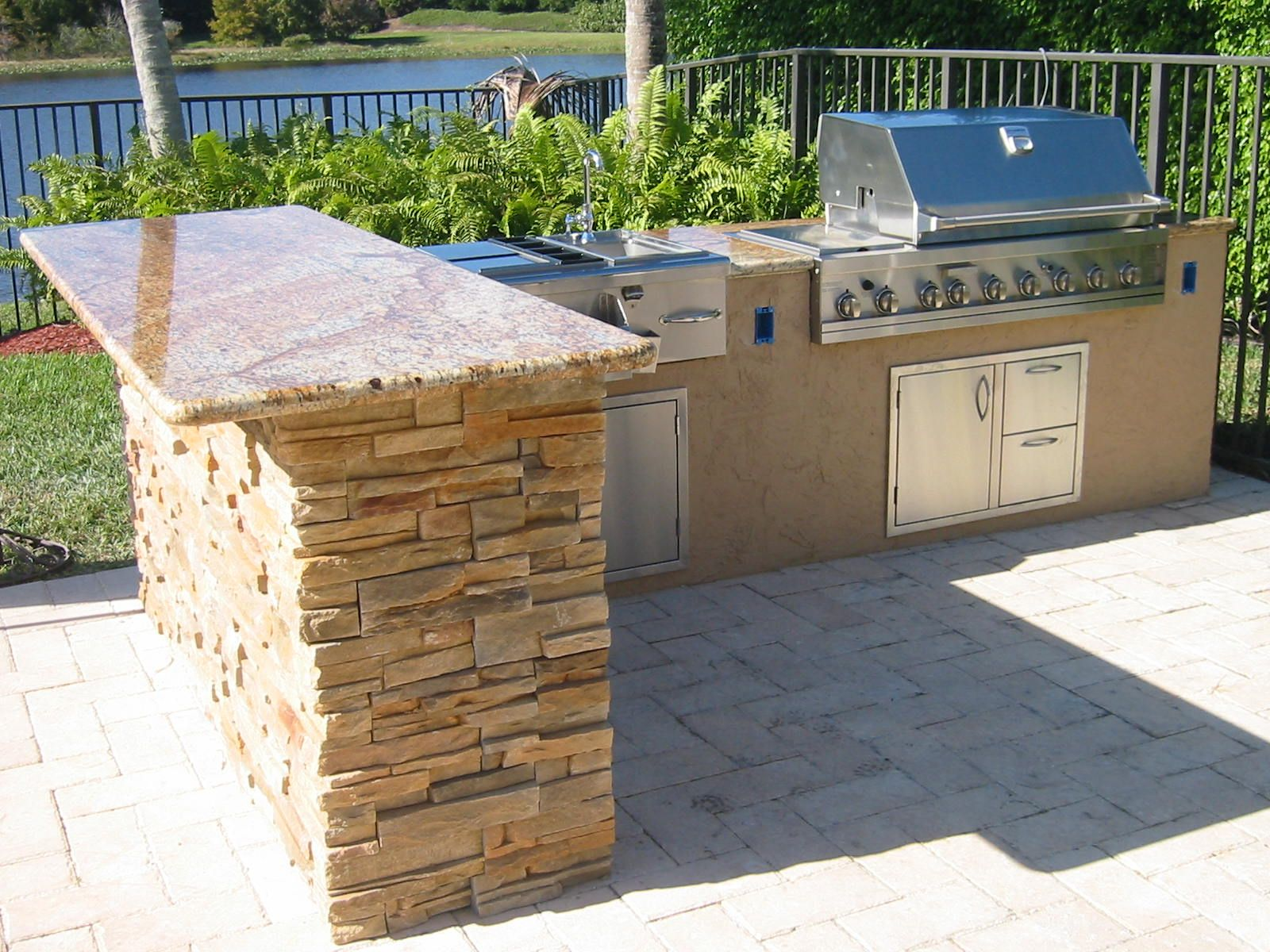 Outdoor Grill Islands Custom Outdoor Kitchen In Florida With Granite And Ledge Stone And Bar