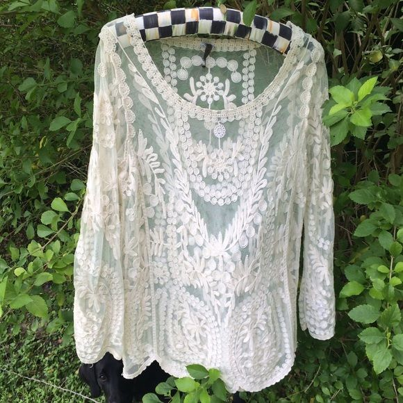 Lace tunic Beautiful XCVI lace tunic. Loose fitting and perfect over skinny jeans. Fit is between a medium and large. XCVI Tops