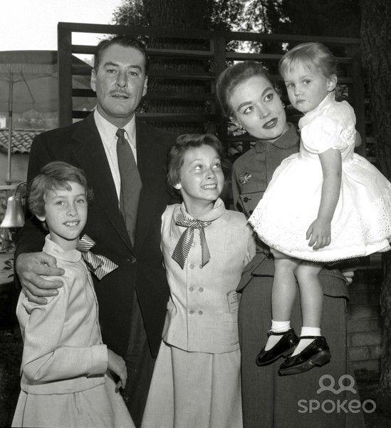 A cozy family portrait- Left to Right: Errol Flynn , Patrice