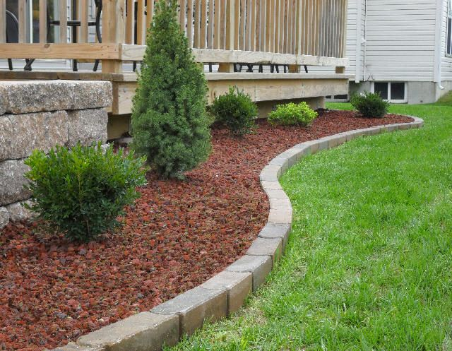 Red lava rock with brick edging curb appeal pinterest for Red stone landscape rock