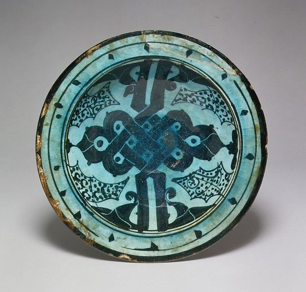 Bowl with Alif-lam Motif Object Name: Bowl Date: 12th century Geography: Syria, Raqqa Culture: Islamic Medium: Stonepaste; polychrome painted under transparent glaze.