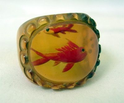 Bakelite apple juice reverse carved/painted fish high domed ring