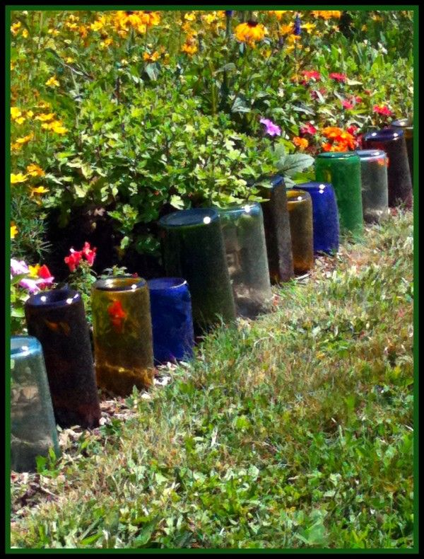 Turning old wine bottles into a garden border.