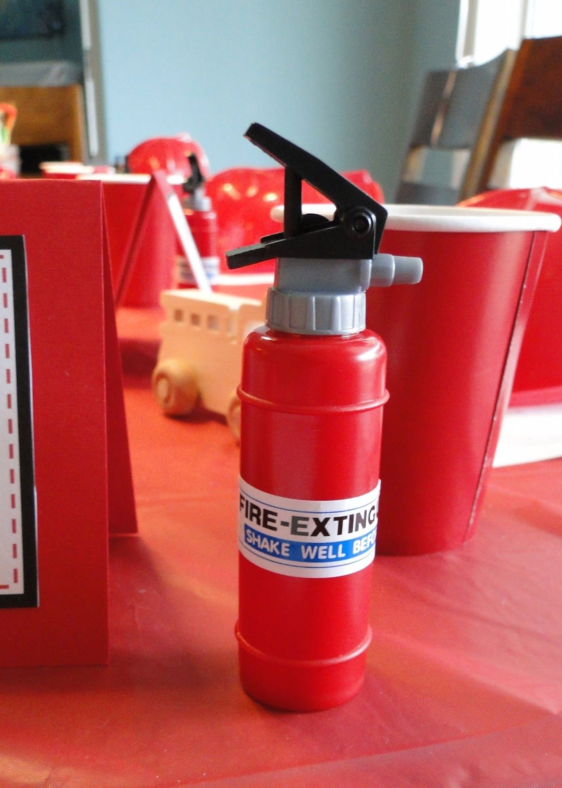 firetruck birthday party fire extinguishers!  Also like the fire truck tires (choc doughnuts) and gummie life savers (your a life saver).