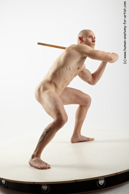 PHOTO OF NUDE FIGHTING MAN WHITE MUSCULAR BALD