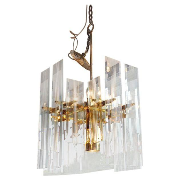A stunning brass and glass chandelier the chandelier features a stunning brass and glass chandelier the chandelier features etched glass panels in two sizes aloadofball Choice Image