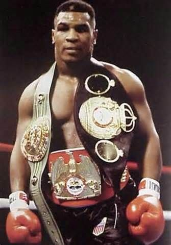 Mike Tyson February 25 1989 Boxer Mike Tyson Becomes The Undisputed Heavyweight Champion Of The World By Defeating Challe Mike Tyson Sports Boxing Champions