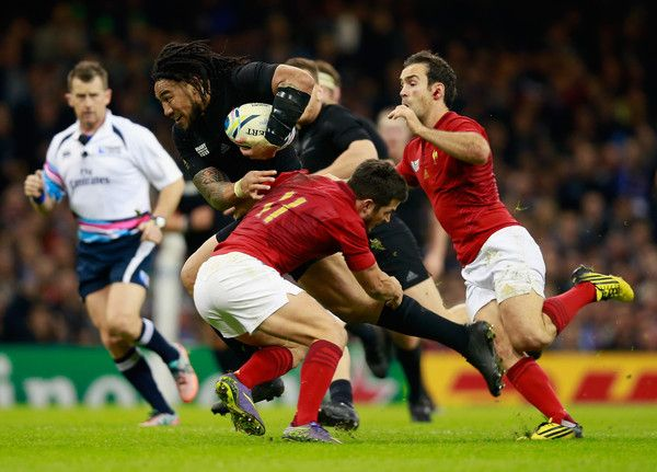 Ma'a Nonu Photos Photos - Ma'a Nonu of the New Zealand All Blacks is tackled by…
