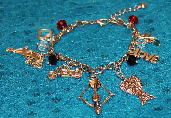 Daryl Dixon Inspired Bracelet Cross Bow Wings by musicissanity, $9.99