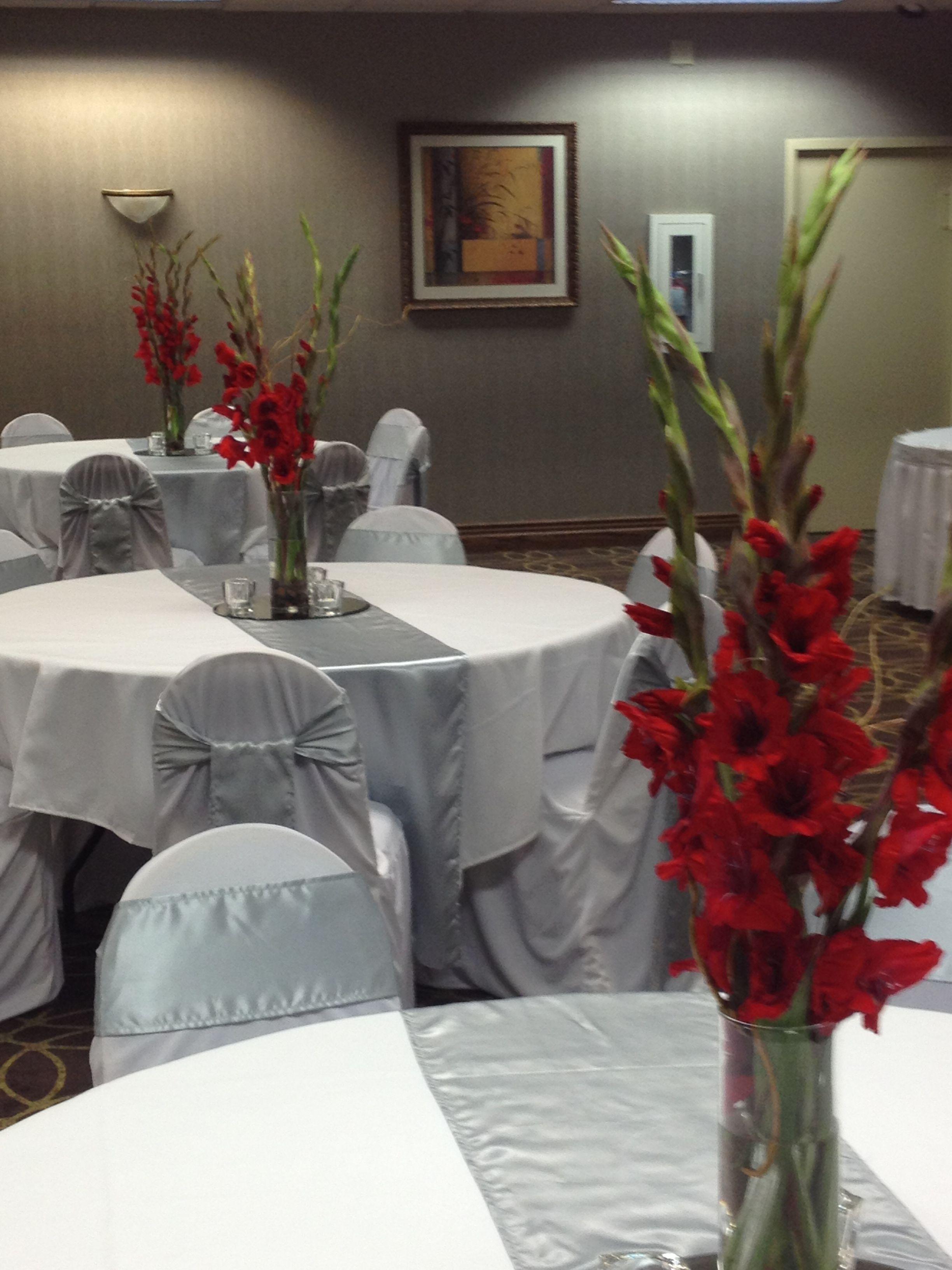 Gladiolus centerpiece in cylinder vase centerpieces
