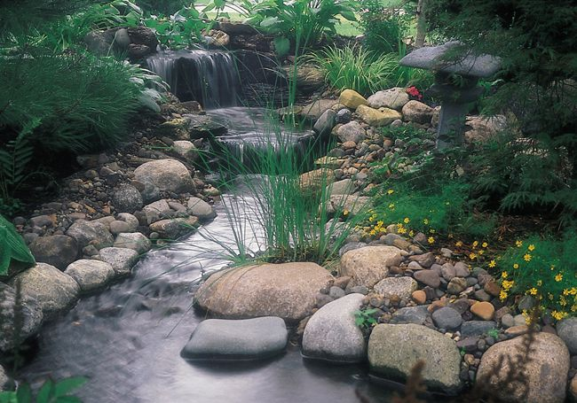 Small Artificial Stream Leading To Waterfall Pond Water ... |Gentle Waterfall Pond