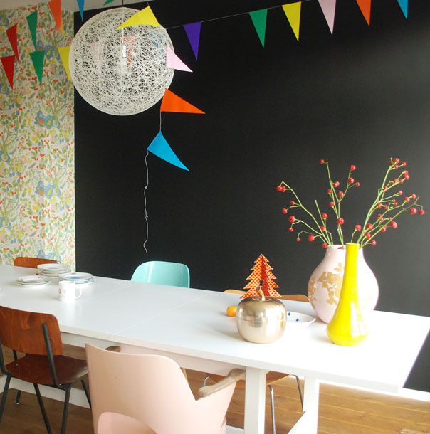 black wall and colorful bunting