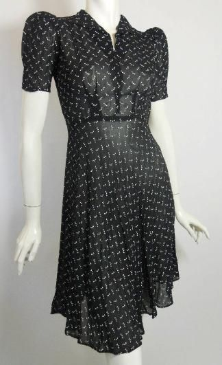 """Late 1930s dress of semi-sheer rayon with screened print of tiny white hearts. Puff sleeves, notched neckline with small rounded collar.  Side zip. No label, no flaws. Petite sizing:  35"""" bust, 26"""" waist, 40"""" hips, 16"""" bodice, 41"""" long. $225"""