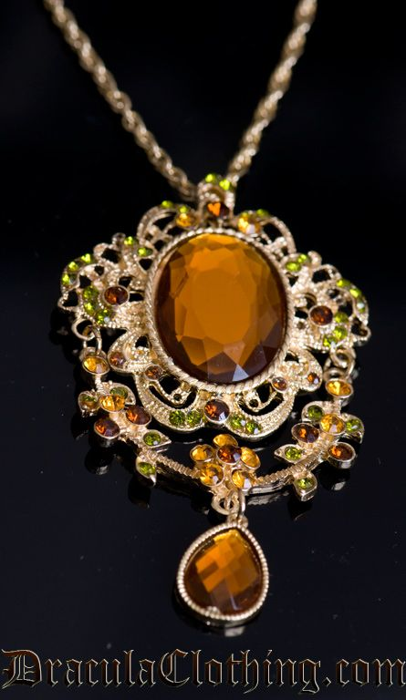 Aristocratic-looking jewellery decorated with brown, orange and green rhinestones.