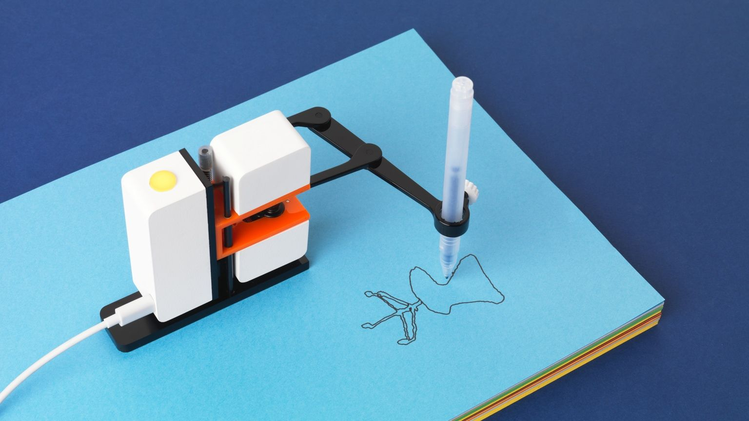 A small robot arm that draws with a pen on paper anything you draw