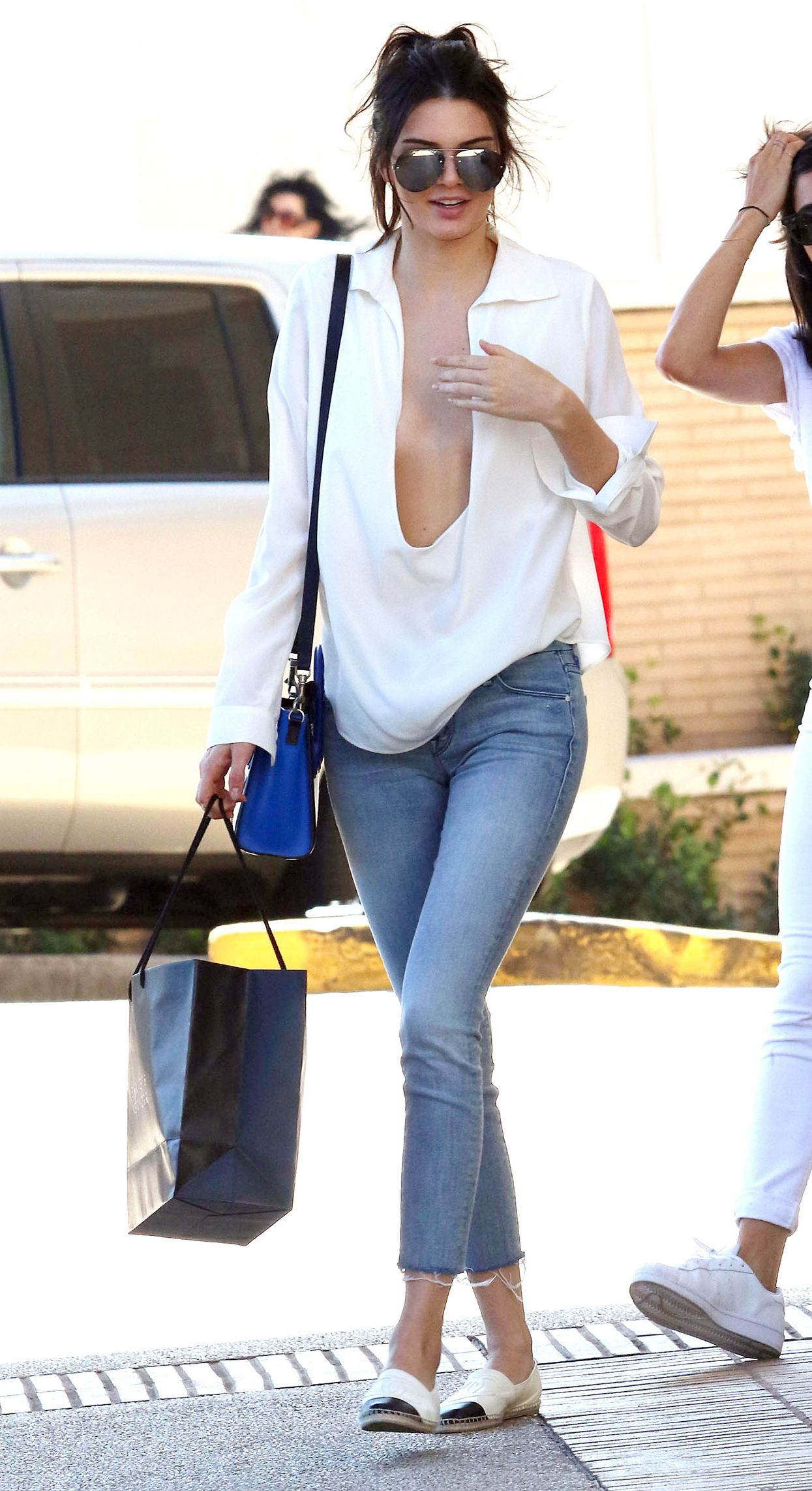 Kendall Jenner Wears the Lowest-Cut White Shirt Ever from  InStyle b67a262d28
