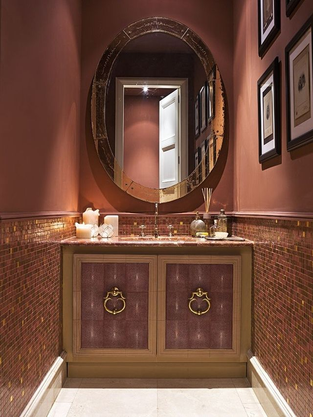 Pretty in pink Powder Room- Design Remix idea: A neutral brown vanity with gold hardeware will also look nice with the pink. Add drama to the lower half of the wall with patterned wallpaper. Make sure the wallpaper has your pink wall color in it to create harmony.