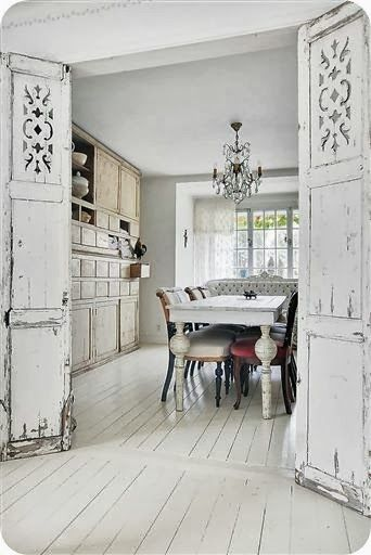 So many wonderful elements in this shabby Norwegian dining room: The doors, white floor, mismatched furniture and built-in cabinet.