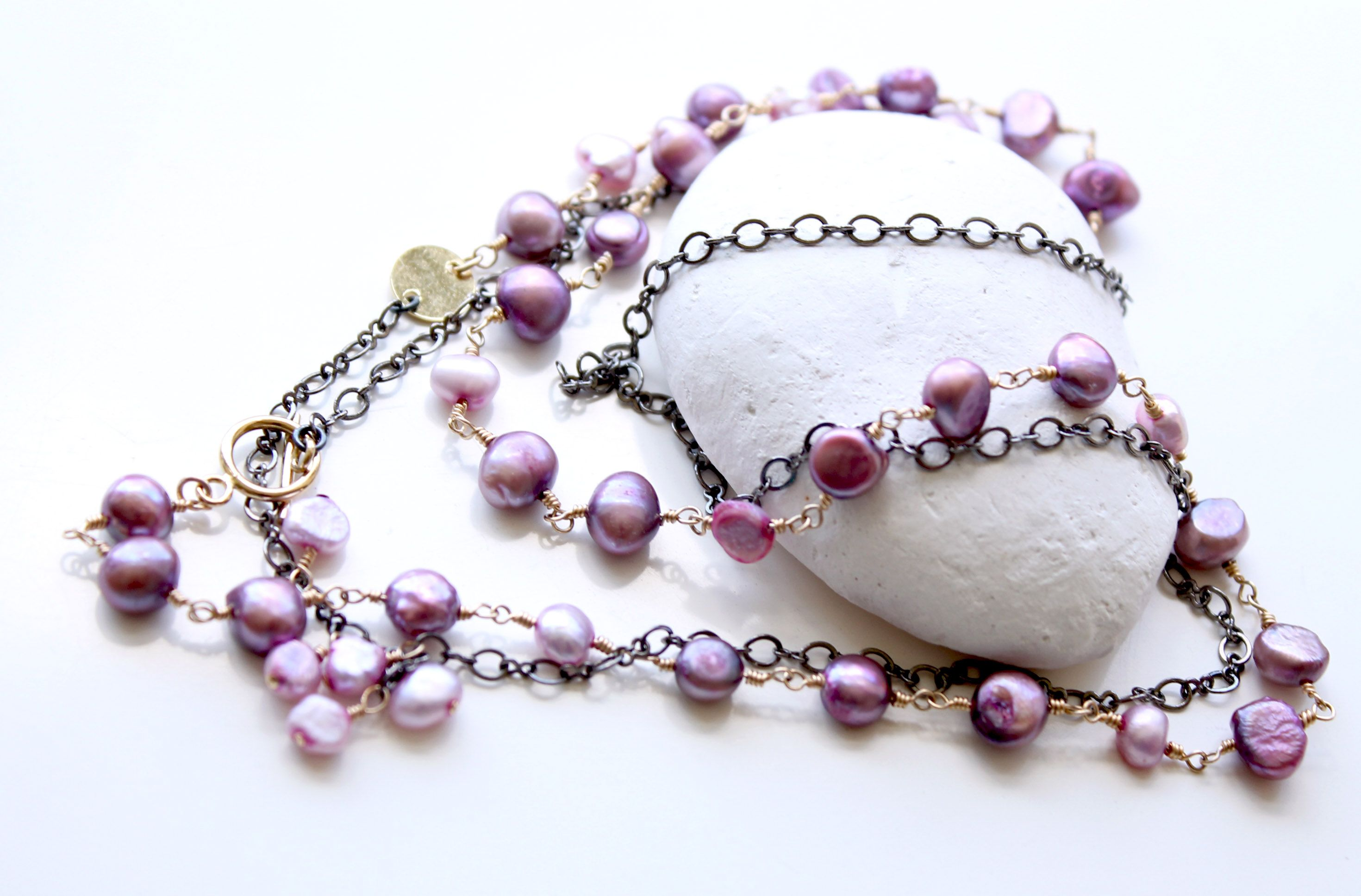 Long mixed metal convertible necklace/bracelet. Gold fill, gun metal with radiant orchid pearl nuggets. Asymmetrical Necklace converts into a bracelet. #layeringnecklace #longnecklace #pearls #mixedmetal
