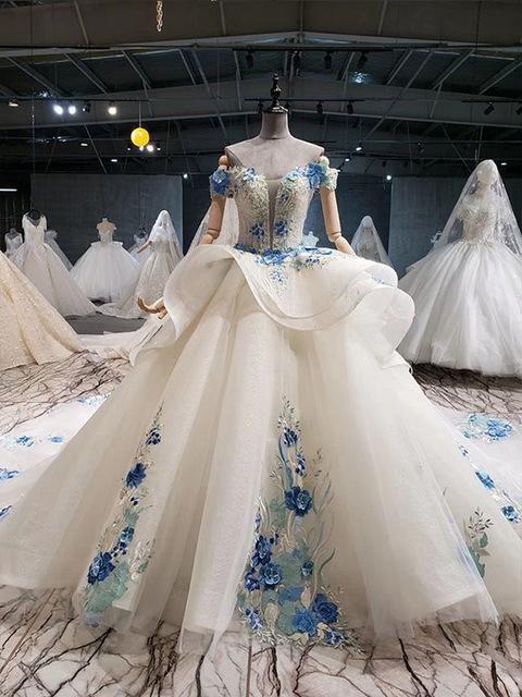 Photo of wedding dress color blue flowers off shoulder sweetheart bea…