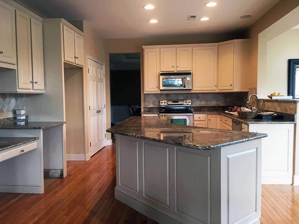 Buttercream Painted Oak Cabinets With White Glaze Painting Oak Cabinets Refinish Kitchen Cabinets Oak Cabinets