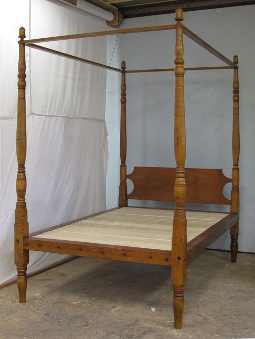 An Antique Four Poster Bed From New