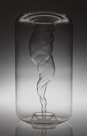 Striking glass vase with a vortex 'captured' inside.
