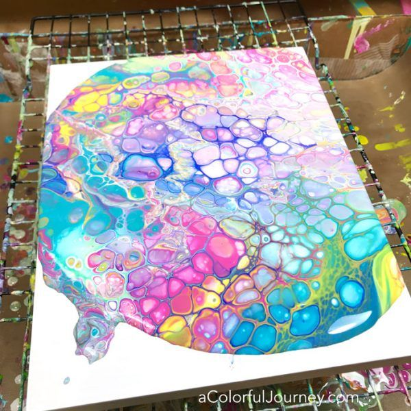 Paint pouring with the primary colors to create a rainbow of cells - tutorial by Carolyn Dube #paintpouring #flipcup