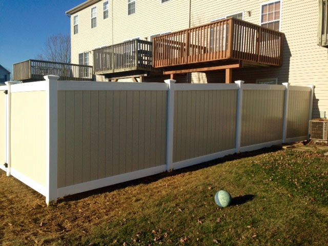 Two Tone Vinyl Privacy Fence style Oklahoma with tan panels white