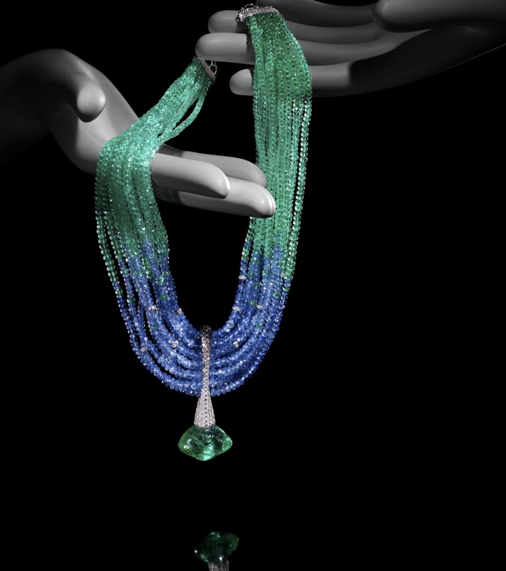 Ariel necklace with strands of beads sapphires and emeralds pendant