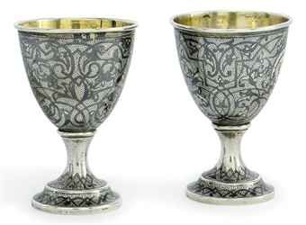 A PAIR OF RUSSIAN SILVER AND NIELLO EGG CUPS