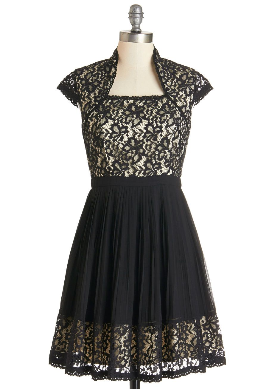 This LBD is full of the loveliest details, including luscious lace and an eye-catching Queen Ann neckline!