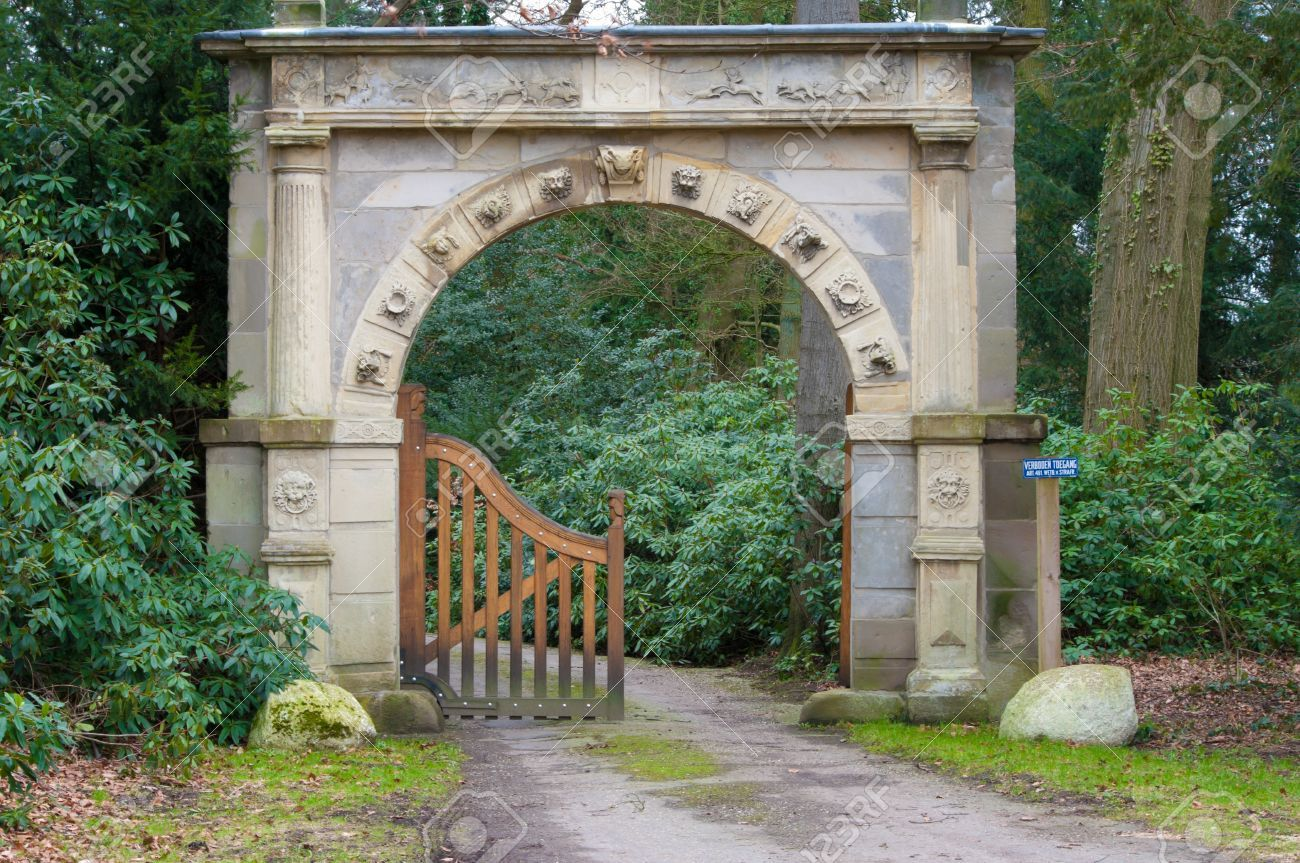 …Ancient Looking Stone Arch Gate Decorated With Zodiac Signs