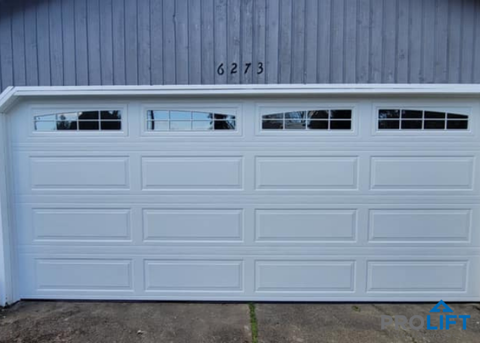 Insulated white steel garage door with windows - energy ...
