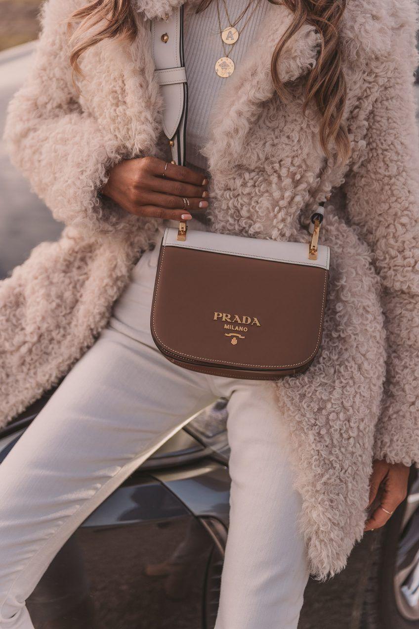 Prada Pionniere bag + pink teddy bear coat outfit 2e48f57d705
