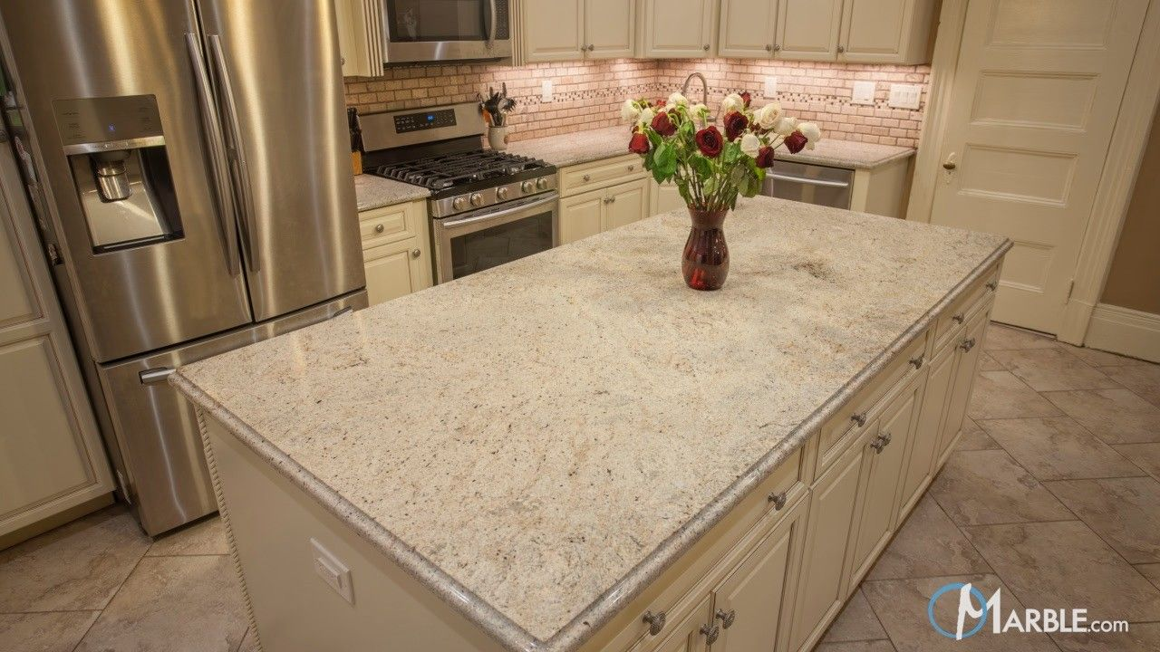 For A Homeowner That S Looking For A Classic White Kitchen Ivory Fantasy Is A Ceramic Tile Floor Kitchen Marble Countertops Kitchen Trendy Kitchen Backsplash