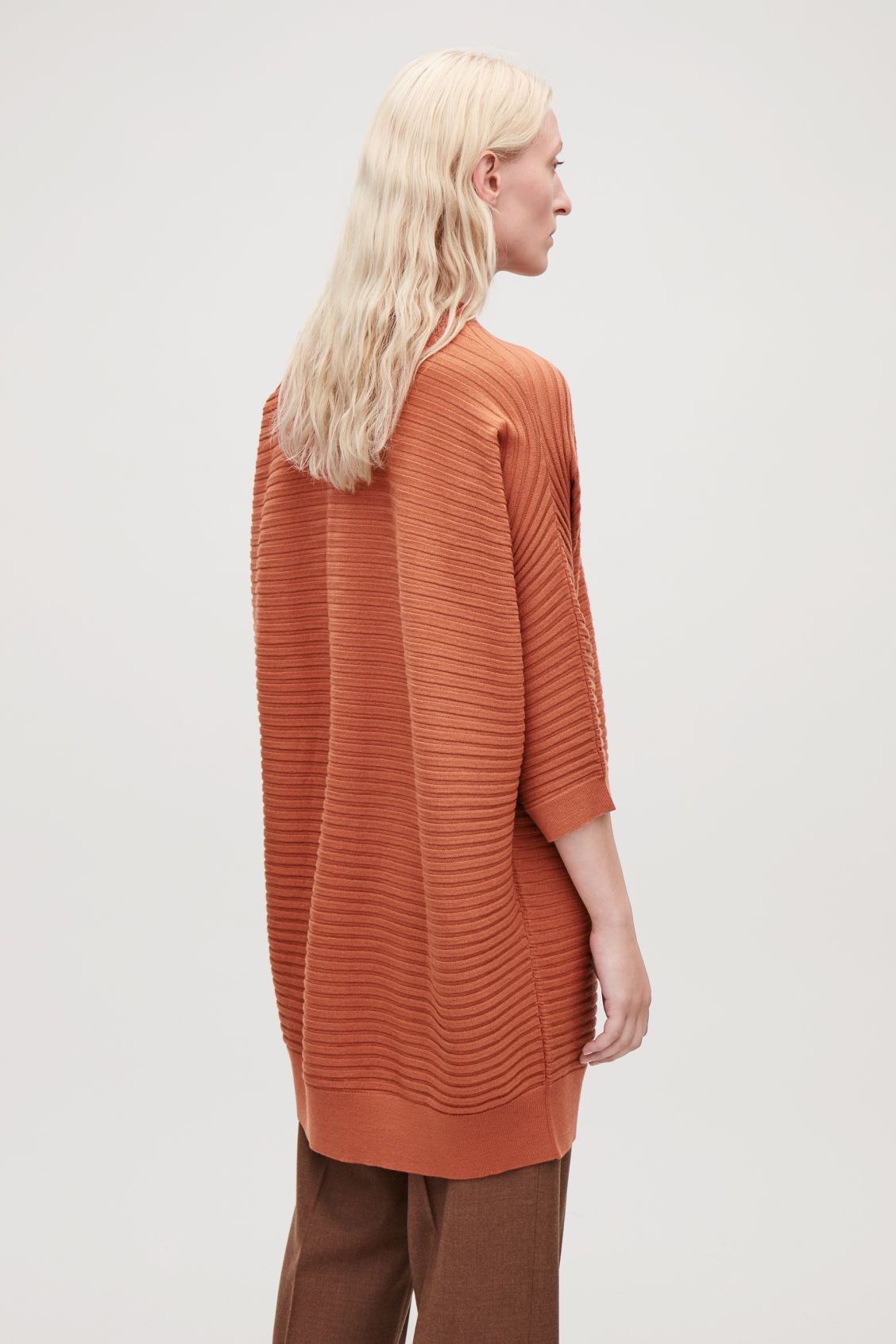 Cos green dress 2018  Model side image of Cos voluminous wool ribknit dress in orange