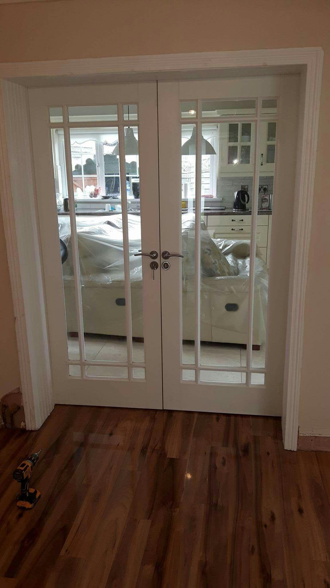 Primed glass doors by Murphy Larkin