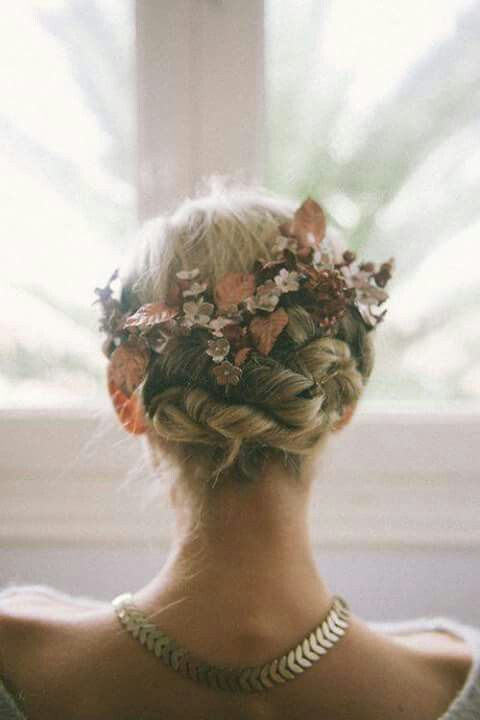 Gorgeous bridal updo with green flora! Lovely!