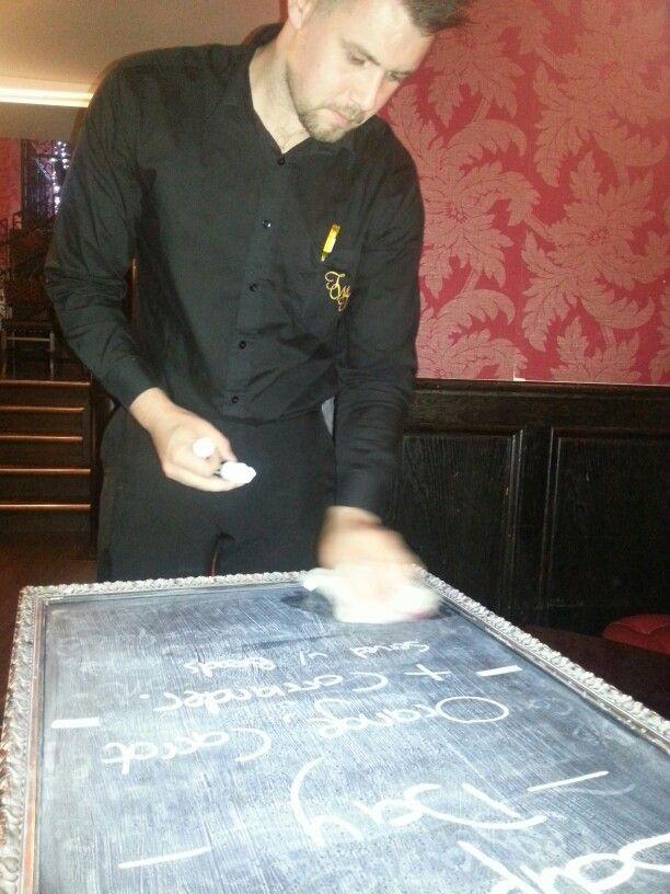 Mark preps evening blackboard specials