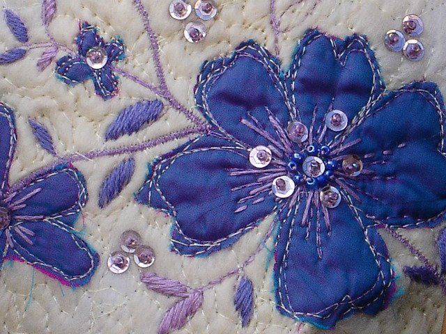 Machine/hand embroidery with applique and sequins. This is a detail from a bag I designed for a wedding.