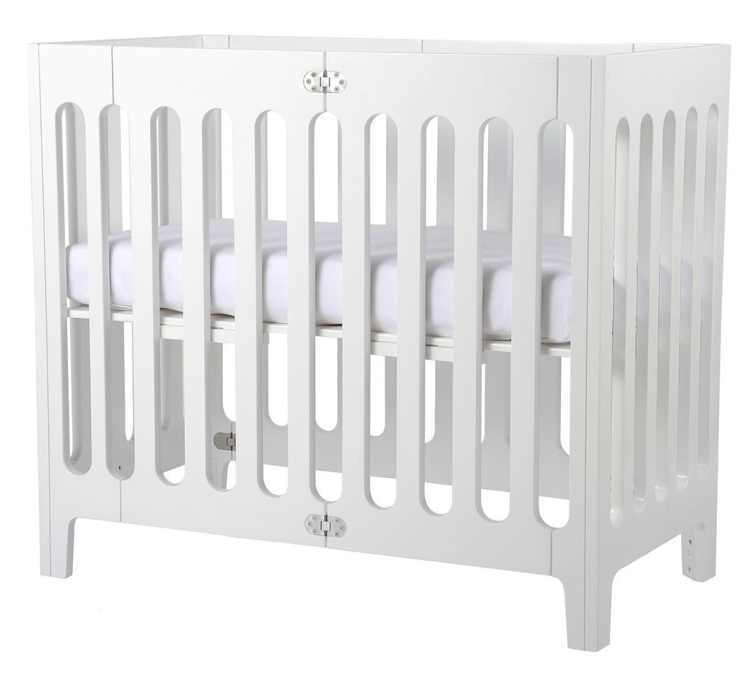 Dream. Roll.  Store.  The Alma urban crib is all about style, mobility, and storage.<br/>This beautifully designed folding wooden crib from Bloom has stainless steel detailing that is a perfect choice for parents looking to bring a chic style to their nur