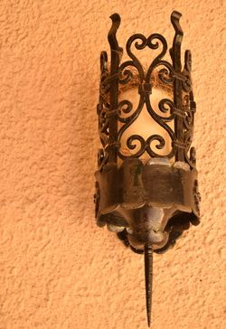 Spring is here! Bird's nest in Mission Revival style outdoor light fixture at Wattle Mansion, Hollywood, California.