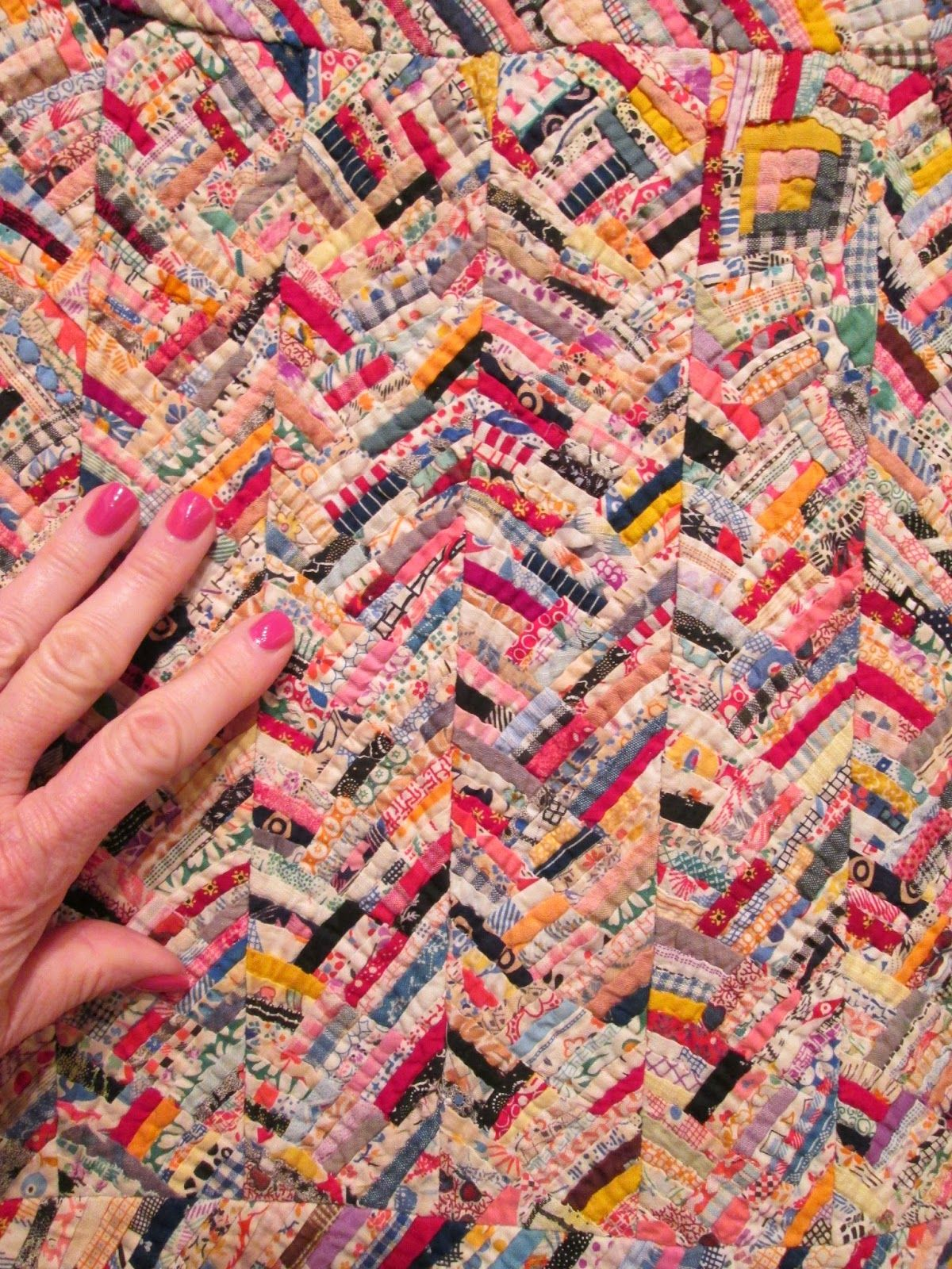 Quilts Etc Teeny Tiny Pieces & Confessions Quilt on display at