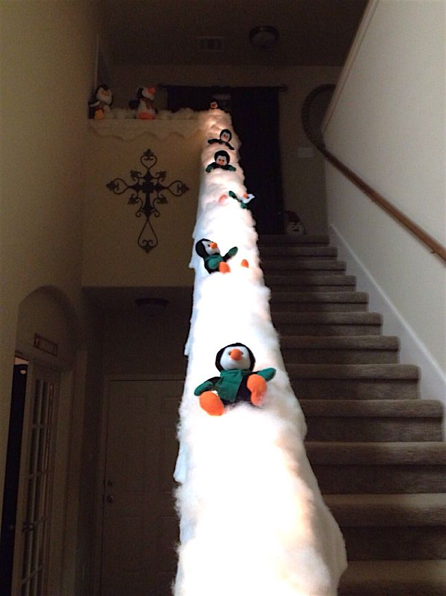 turn your banister into a holiday slide such a cute holiday decoration and so easy to make