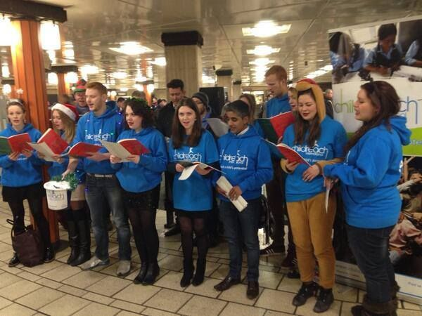 Childreach International employees at our London office carol sing in a tube station