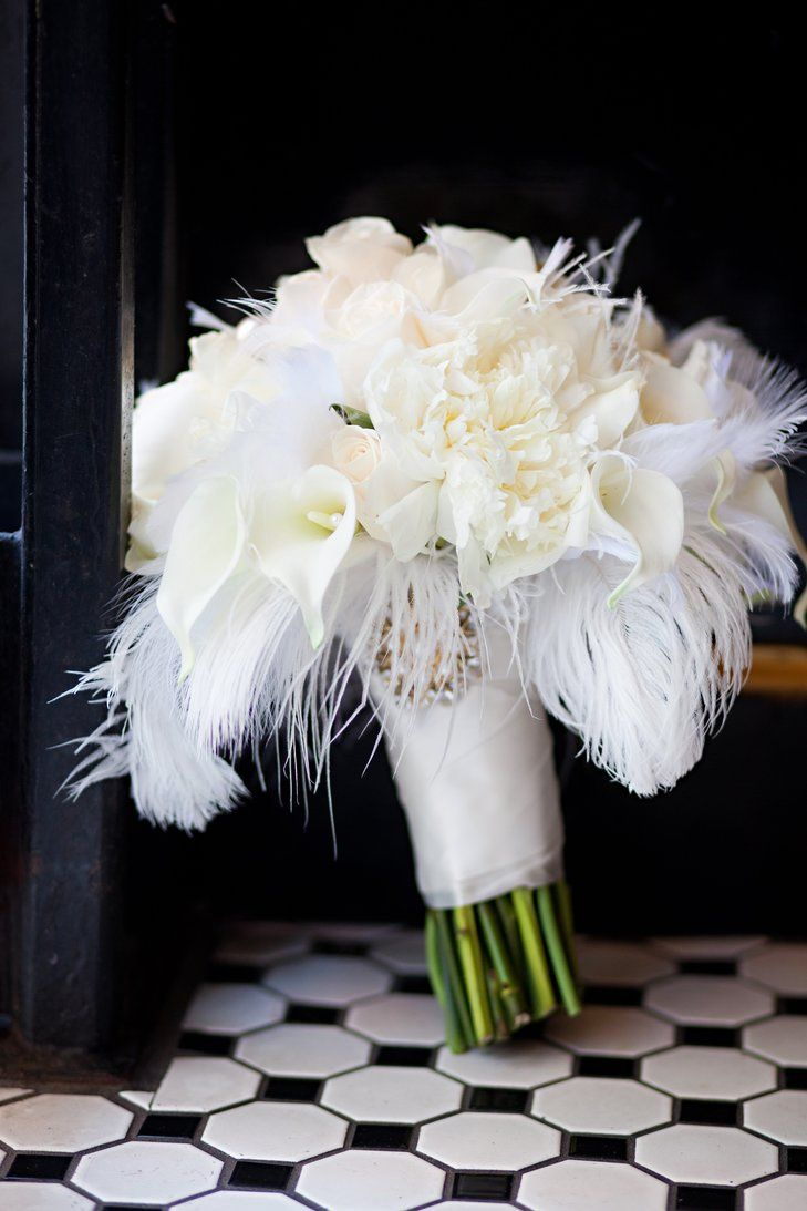 White Feather Bouquet | Mary's Country House Of Flowers https://www.theknot.com/marketplace/marys-country-house-of-flowers-cincinnati-oh-308328